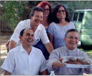 Fr. Gabriel Ruiz, cmf, serving food at the pot-luck dinner after his anniversary Mass